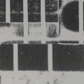 Detail of an abstract print in black and white of an irregular rectangular pattern.